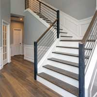 Gray stairs and wood floor